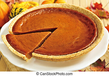 Pumpkin pie - Whole pumpkin pie with a slice cut out