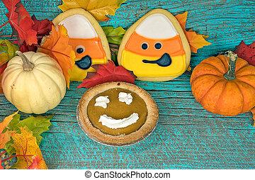 pumpkin pie with autumn cookies and pumpkins