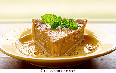 pumpkin pie with mint garnish and copyspace