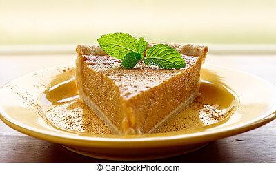 pumpkin pie with mint garnish and copyspace