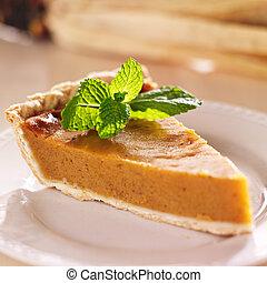 pumpkin pie with mint garnish closeup