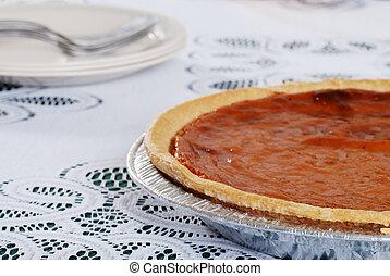 pumpkin pie with plates