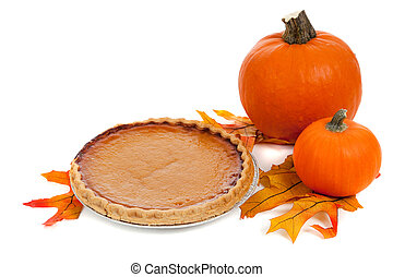 Pumpkin pie with pumpkins and fall leaves on white