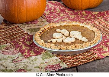 Pumpkin pie with pumpkins