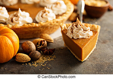 Pumpkin pie with whipped cream - Sweet pumpkin pie slice...