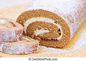Pumpkin Roll - Delicious Pumpkin Roll sprinkled with...