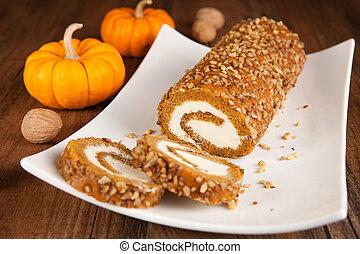 Sliced pumpkin roll on a plate