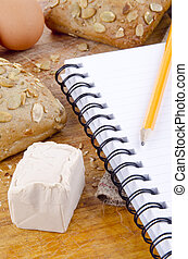 pumpkin seed roll and a booklet for notes