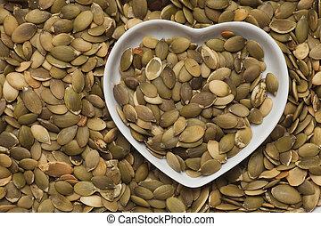 Pumpkin seed snack in heart shaped tray