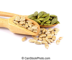 Pumpkin seeds and sunflowers seeds in wooden spoon isolated on white background