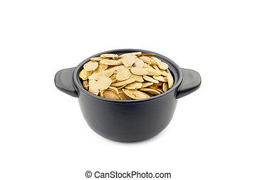 Pumpkin Seeds in a Black Cup