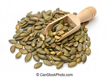 pumpkin seeds in a wooden scoop
