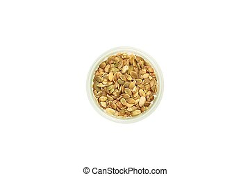 Pumpkin seeds in container. Top view. Isolated.