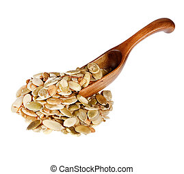 Pumpkin seeds in the wooden spoon, isolated on white background.