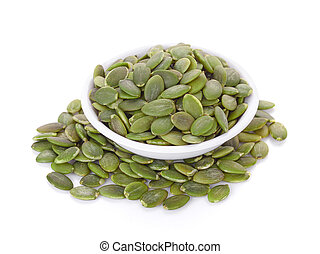 pumpkin seeds in white bowl isolated on white background