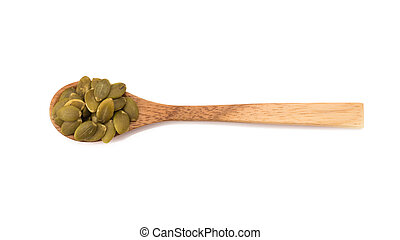 Pumpkin seeds in wooden spoon isolated on white background.