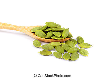 pumpkin seeds in wooden spoon isolated on white