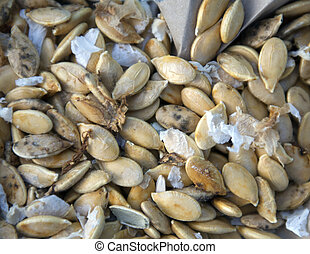 Pumpkin seeds on the white background