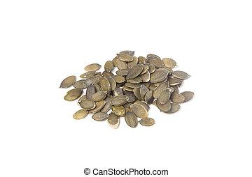 Pumpkin seeds on white background