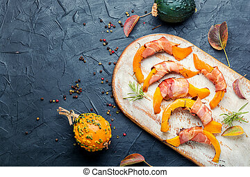 Pumpkin slices wrapped in bacon