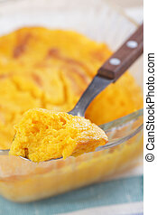 Pumpkin souffle in the spoon closeup