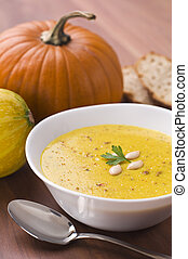 Fresh pumpkin soup with parsley close up
