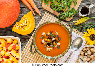 Pumpkin soup in a bowl with Ingredients