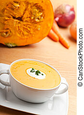 pumpkin soup in a white bowl