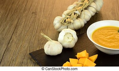 Pumpkin Soup on wooden table.