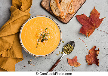 Pumpkin soup puree or cream soup in bowl