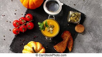 Pumpkin soup with bread and vegetables - From above view of...