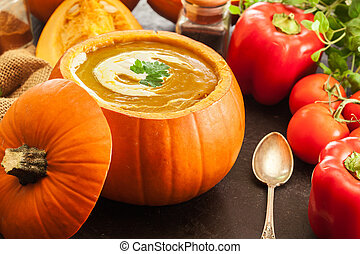 Pumpkin soup with cream in a pumpkin