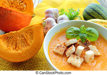Pumpkin soup with fresh basil and croutons