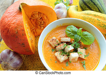 Pumpkin soup with fresh crounons and herbs