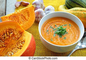 Pumpkin soup with fresh herbs and pumpkins
