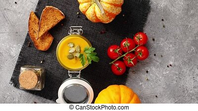 Pumpkin soup with vegetables on napkin - From above view of...