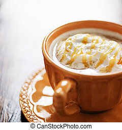 pumpkin spiced latte coffee drink with caramel and cream