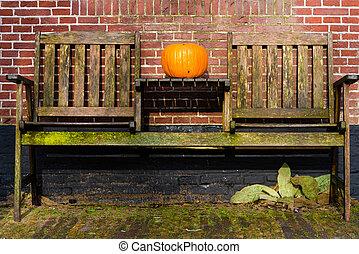 Pumpkin standing on vintage wooden table