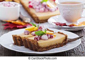 Pumpkin tart on gingerbread crust with candied cranberry