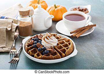 Pumpkin waffles with whipped cream for breakfast - Pumpkin...