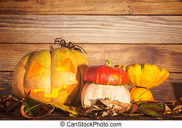 Pumpkin with autumn leaves