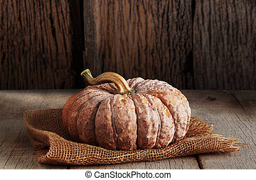Pumpkin with wood background.