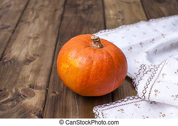 pumpkin yellow is big for Halloween and cooking different food, on a wooden background. Photo in the style of rustic. Copy space