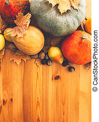 Pumpkins, autumn leaves, apples, pears, corn, nuts and chestnuts on wooden rustic table. Flat lay with space for text. Happy Thanksgiving concept . Phone photo