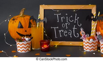 pumpkins, candies and halloween decorations - halloween and ...