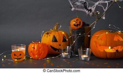 pumpkins, candles and halloween decorations - halloween and ...