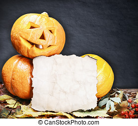 pumpkins for Halloween and sheet of paper