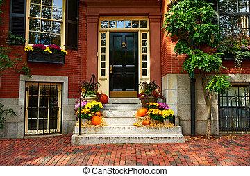 Pumpkins near the door for Halloween - Pumpkins near the...