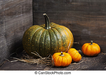 pumpkins on old wooden table