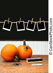Pumpkins on school desk in classroom